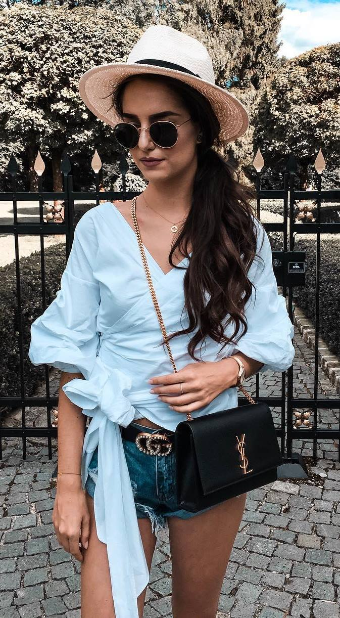 how to wear a hat : blue v-neck blouse + bag + denim shorts