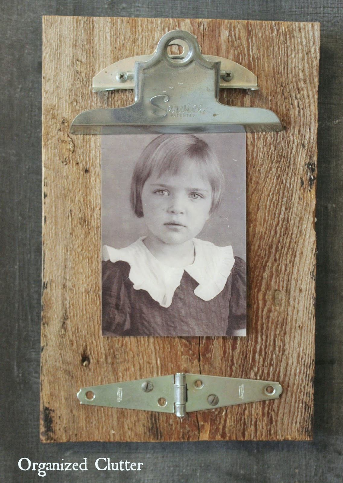 Repurposed Clipboard Photo Display On Barn Wood www.organizedclutter.net