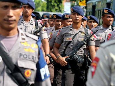 Indonesian police officers in Cilacap