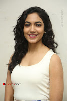 Actress Ritu Varma Stills in White Floral Short Dress at Kesava Movie Success Meet .COM 0007.JPG