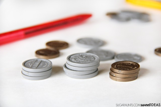 Counting coins math for kids, including making change and fine motor skills with hands on coin counting math.