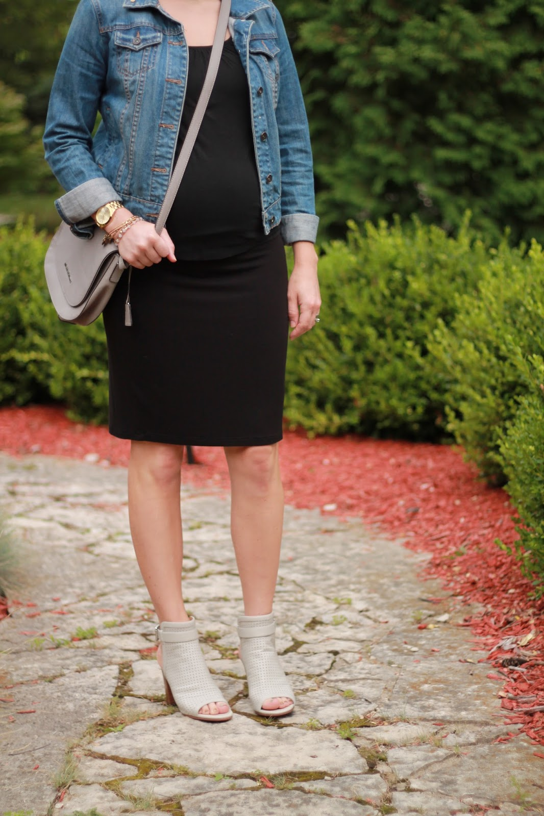black tee, black pencil skirt, Sam Edelman peep toe booties, grey crossbody bag, denim jacket, second trimester summer maternity outfit,
