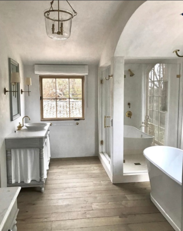 European farmhouse interior design style in a romantic bathroom with Swedish antique vanity - found on Hello Lovely Studio