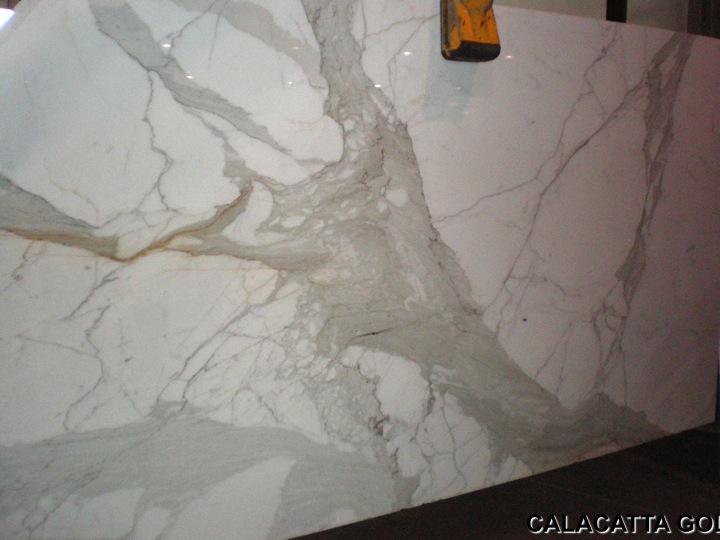 A Posh Place Carrara White Vs Calcutta Gold