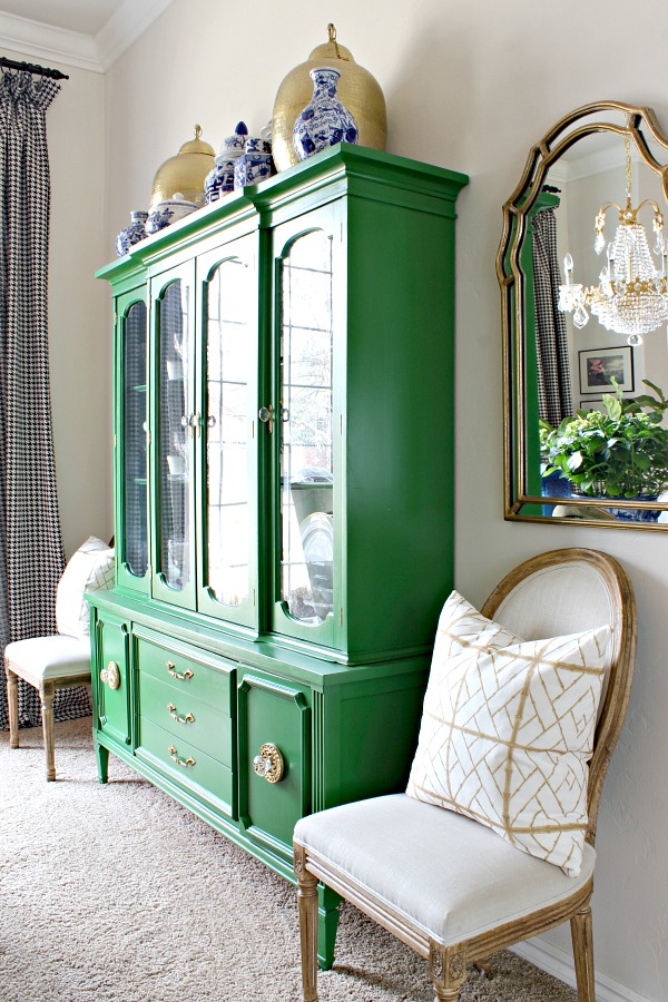 Shelby Dillow Studio bamboo lattice pillow, green china cabinet, china hutch styling, louis dining chairs, uttermost petrizzi wall mirror