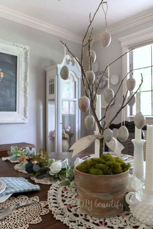 antiqued eggs on DIY tree for a pretty Easter centerpiece