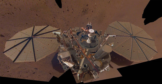 This is NASA InSight's second full selfie on Mars. Since taking its first selfie, the lander has removed its heat probe and seismometer from its deck, placing them on the Martian surface; a thin coating of dust now covers the spacecraft as well. Credits: NASA/JPL-Caltech
