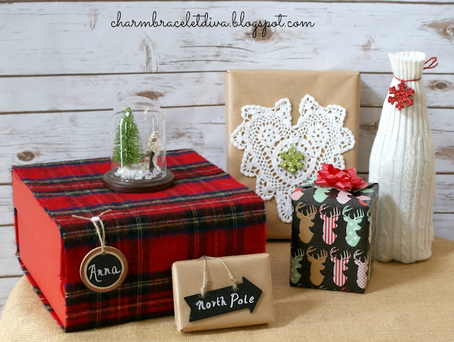 wrapped presents Christmas boxes red plaid scarf sweater bottle cover cloche