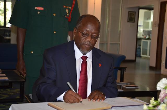 Image result for images of President Magufuli signing