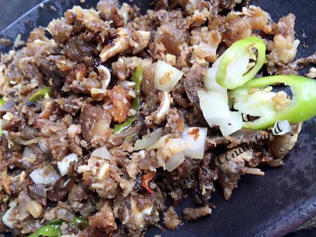 Taaleña: Sizzling Pork Sisig