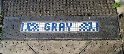 Blue and white mosaic street marker on the Midtown segment of Gray Street