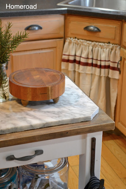 Cutting board with skirted sink in background