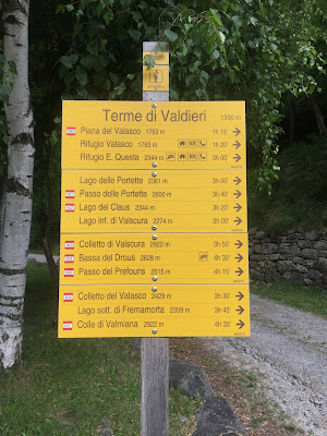 A sign describing places and times to reach them at Terme di Valdieri