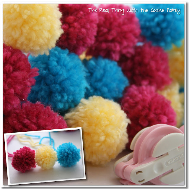 Make this adorable American Girl Doll craft of a Pom Pom Scarf for your doll. Too Cute! #AGDoll #Crafts #AmericanGirlDoll #RealCoake