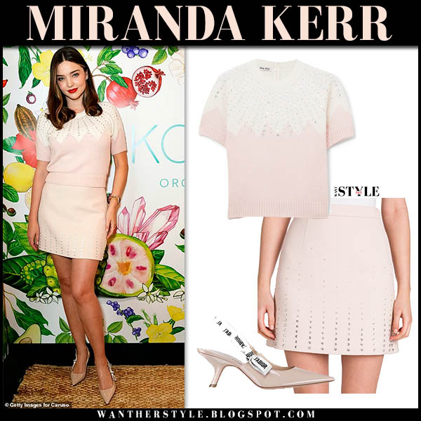 Miranda Kerr in pale pink short sleeve miu miu sweater and pink mini skirt with dior ribbon pumps celebrity feminine style november 29
