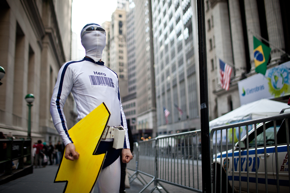 Alan Yang dresses up as Captain Generica for Monday's superheroes march to the New York Stock Exchange.