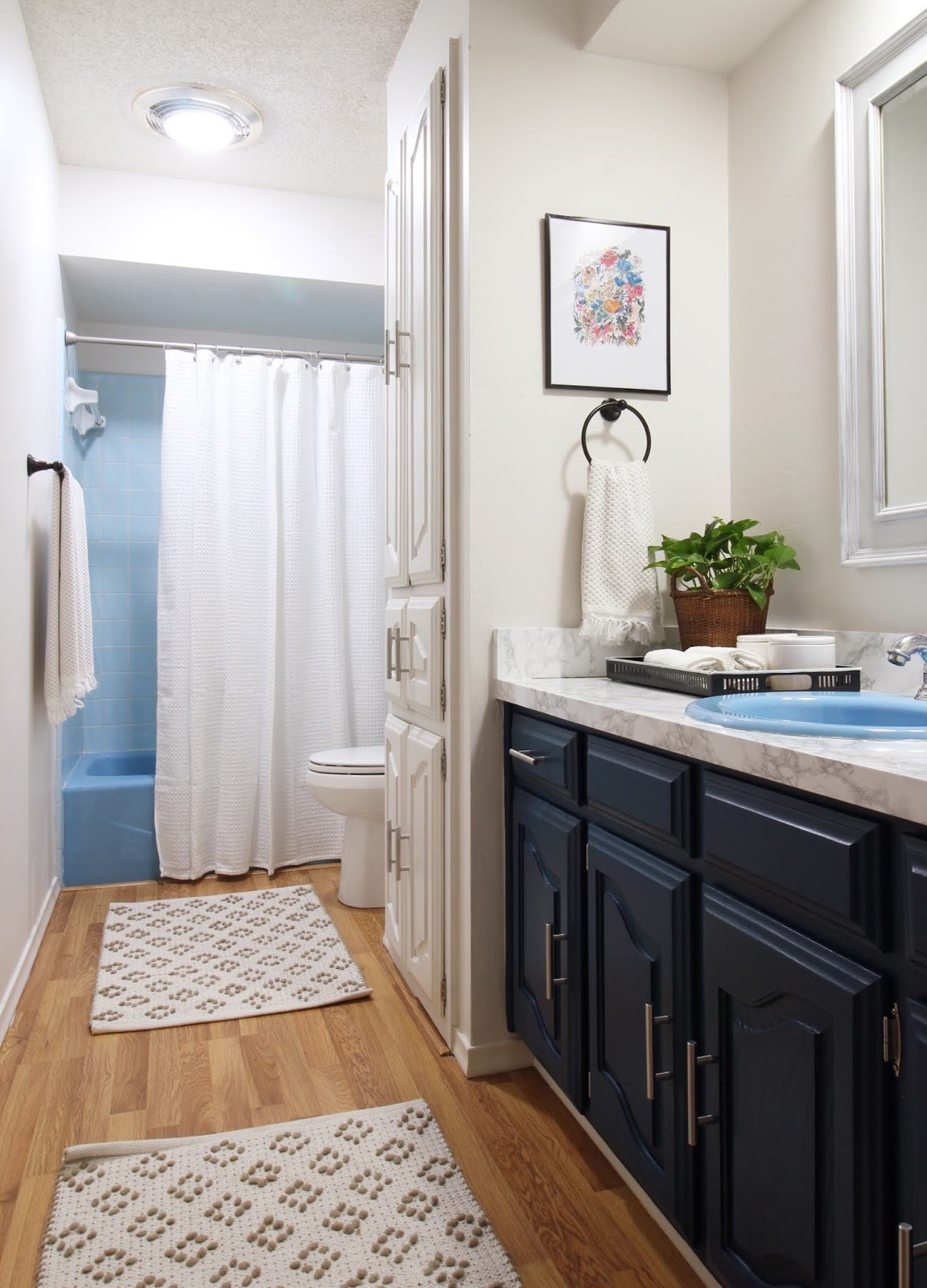 Come see what we did to make this outdated blue tiled bathroom charming and more modern! | House Homemade