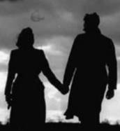 Imagen de 2 enamorados en la oscuridad