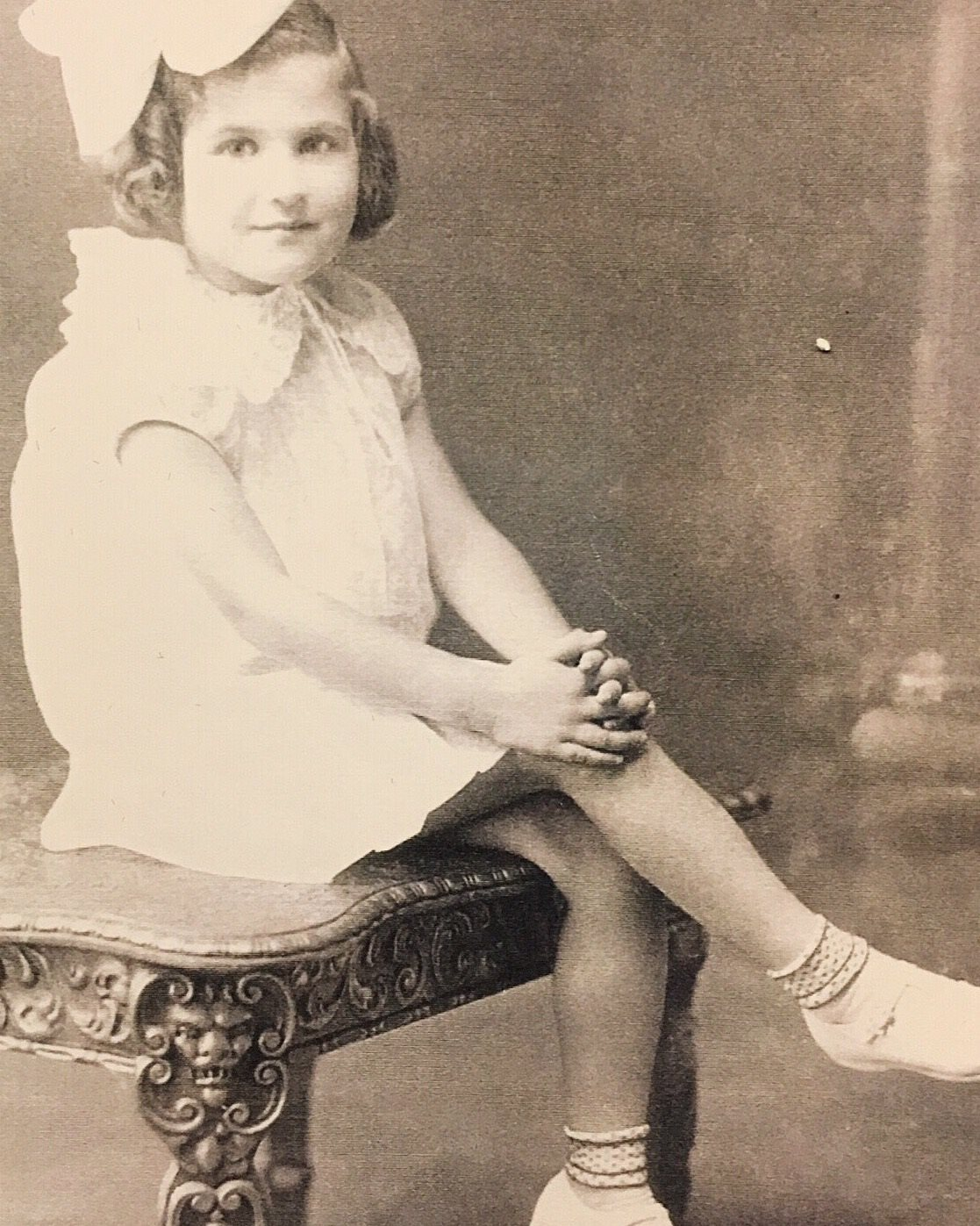 Old photo of little girl wearing white clothing