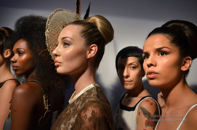 Models in a row before the exit to the catwalk for the Panos Apergis collection.