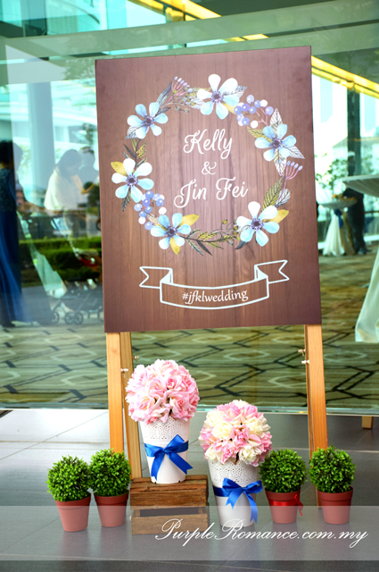 grass backdrop, garden theme, wedding setup, decoration, decor, deco, backdrop, stage, photo booth backdrop, instant print service, green, white fence, pink flowers, maison jars, logo JK, light bulbs, rustic, bangsar south, nexus connexion, gazebo, walkway, pom pom flowers, royal blue, light blue, carpet, ballroom, oak room, ROM, wedding malaysia, seremban, melaka, pahang, reception table, signage, silver holder, table runner, petals, strands of pearls