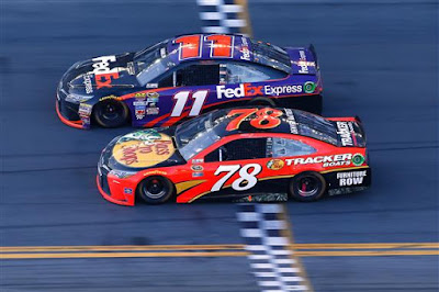 Denny Hamlin takes the checkered flag ahead of Martin Truex Jr. to win the #NASCAR Sprint Cup Series DAYTONA 500.