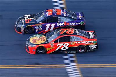 Denny Hamlin takes the checkered flag ahead of Martin Truex Jr. to win the #NASCAR Sprint Cup Series DAYTONA 500.