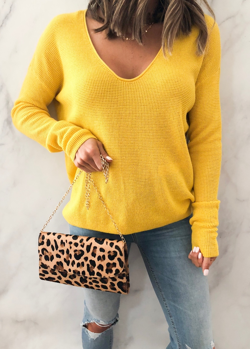 how to style a leopard bag : yellow v-neck sweater + skinnies