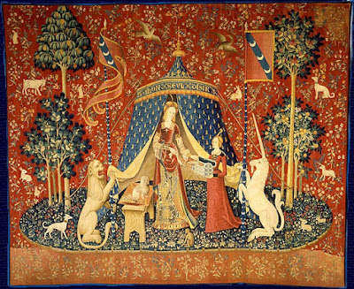 """The Lady and the unicorn Desire"" by Unknown - http://www.tchevalier.com/unicorn/tapestries/desir.html#. Licensed under Public Domain via Commons - https://commons.wikimedia.org/wiki/File:The_Lady_and_the_unicorn_Desire.jpg#/media/File:The_Lady_and_the_unicorn_Desire.jpg"