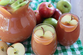 fall harvest party punch with apples and pears in a pitcher and glass