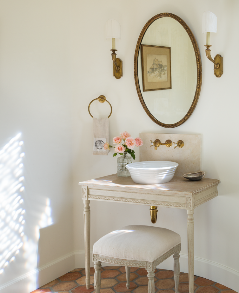 Swedish antique used as vanity in French Country powder room by Giannetti Home - found on Hello Lovely Studio