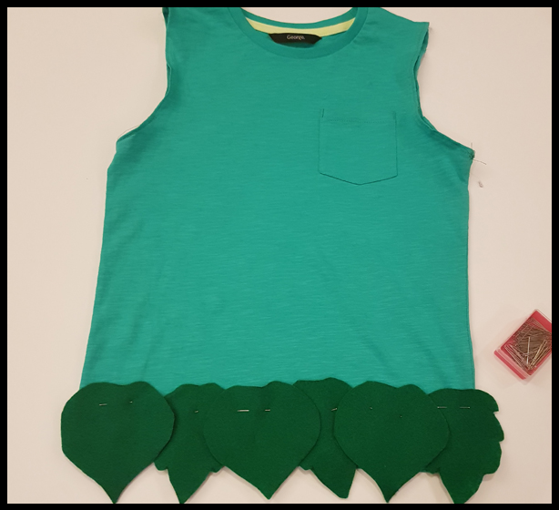 Hand sew leaf shaped felt on to a T-Shirt to make a branch outfit