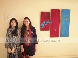 syeda hera shakoor with her work on display at NCA art gallery Rawalpindi