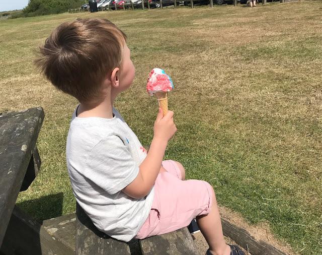 at the beach enjoying an icecream