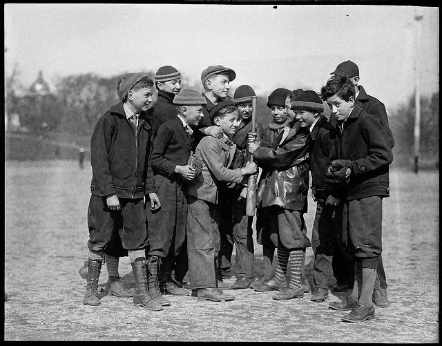 Boys choose  sides for a back lot baseball game. c1910 Go Home, marchmatron.com