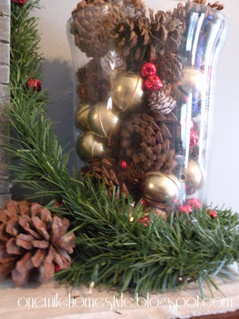 Vase display of pine cones with brass and red bells - Christmas decor