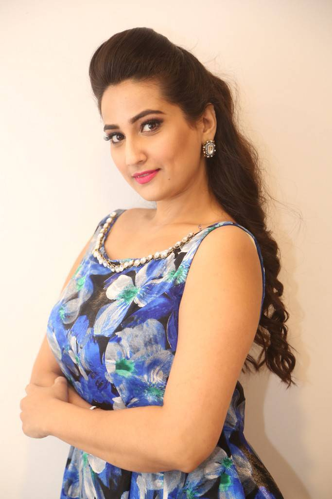 tollywood actress manjusha long hair stills in sleeveless blue dress