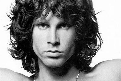 """Biografi Jim Morrison    Jim Morrison, yang memiliki nama asli James Douglas Morrison, lahir di Florida, Amerika Serikat pada 8 Desember 1943 dari pasangan George Stephen Morrison dan Clara Clark Morrison. Januari 1964 Morrison lulus dari UCLA jurusan Theater Arts Departement of the College of Arts.  Nama Jim Morrison besar sebagai vokalis The Doors yang didirikan tahun 1965 di Los Angeles, bersama kibordis Ray Manzarek. Band yang paling kontroversial pada jamannya karena lirik yang samar, terkadang sangat vulgar dan tidak diduga. Kala itu Manzarek sangat terkesan dengan puisi buatan Morrison yang berjudul """"Moonlight Drive"""" lalu dibentuklah The Doors dengan formasi kibordis Ray Manzarek, vokalis Jim Morrison, drummer John Densmore, dan gitaris Robby Krieger. Nama band The Doors diambil dari buku karya Aldous Huxley, """"The Doors of Perception"""".  Secara lirikal, The Doors membawa latar musik rock baru dengan suasana yang kompleks, surealis dan sugestif yang mengeksplorasi seks, mistisisme, obat-obatan, pembunuhan, kegilaan hingga kematian. Hal yang mengangkatnya juga menjadi penghambatnya, seperti saat tampil di Ed Sullivan Show dengan lirik """"Light My Fire"""" yang harus dirubah demi kesopanan.  Ditahun 1966 The Doors tampil di Whisky a Go Go ( Sebuah diskotik di California Selatan"""