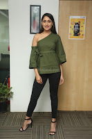 Pragya Jaiswal in a single Sleeves Off Shoulder Green Top Black Leggings promoting JJN Movie at Radio City 10.08.2017 054.JPG