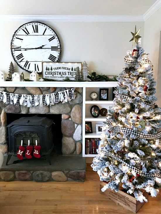 Christmas tree and black and white mantel.