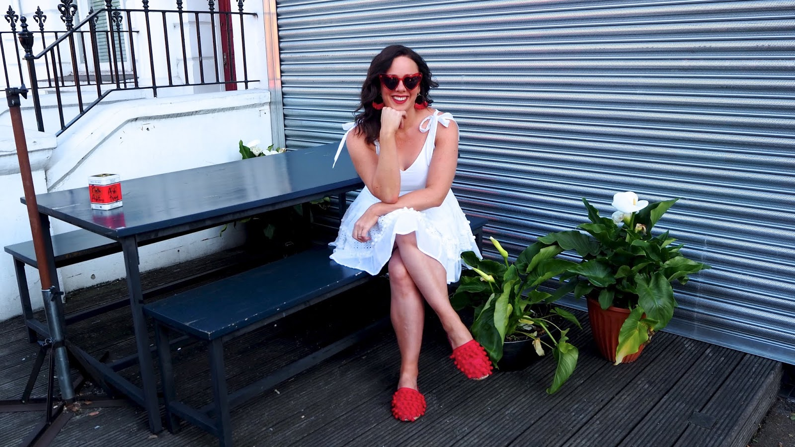 white dress, red shoes, red heart sunglasses