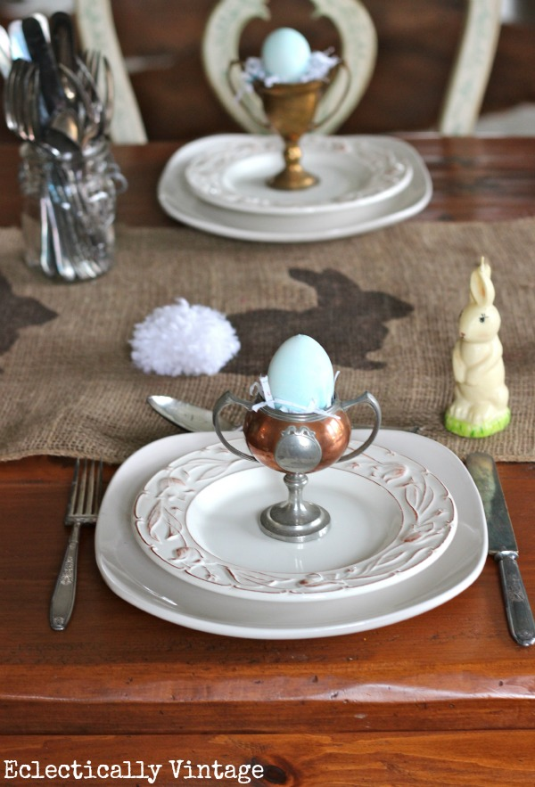 These small vintage trophies make unique place setting on this table scape