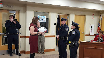 Town Clerk Teresa Burr swearing two new police officers in October 2016