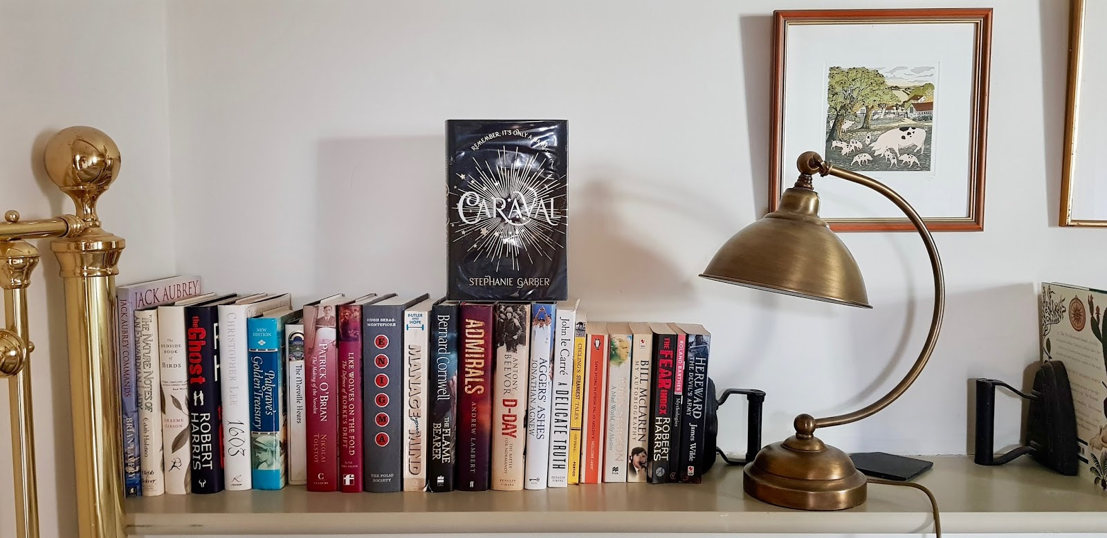 black and silver book on bookshelf