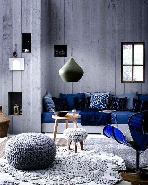 cosy and bohemian dark blue and grey living room