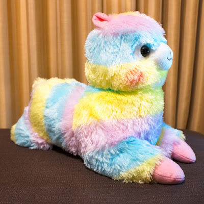 Alpacasso Tissue Box plushie in rainbow colors.