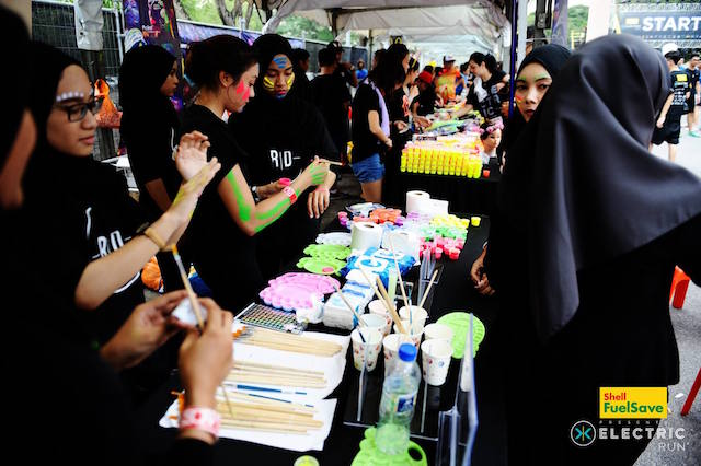 Earlier in the evening, participants got to get their hands, faces and feet painted with glow in the dark paint