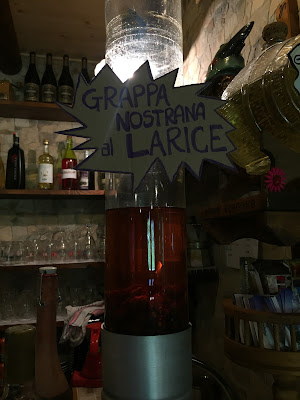 "Grappa Nostrana al Larice - ""Our grappa made from larch"" pine cones at Rifugio Dordona."
