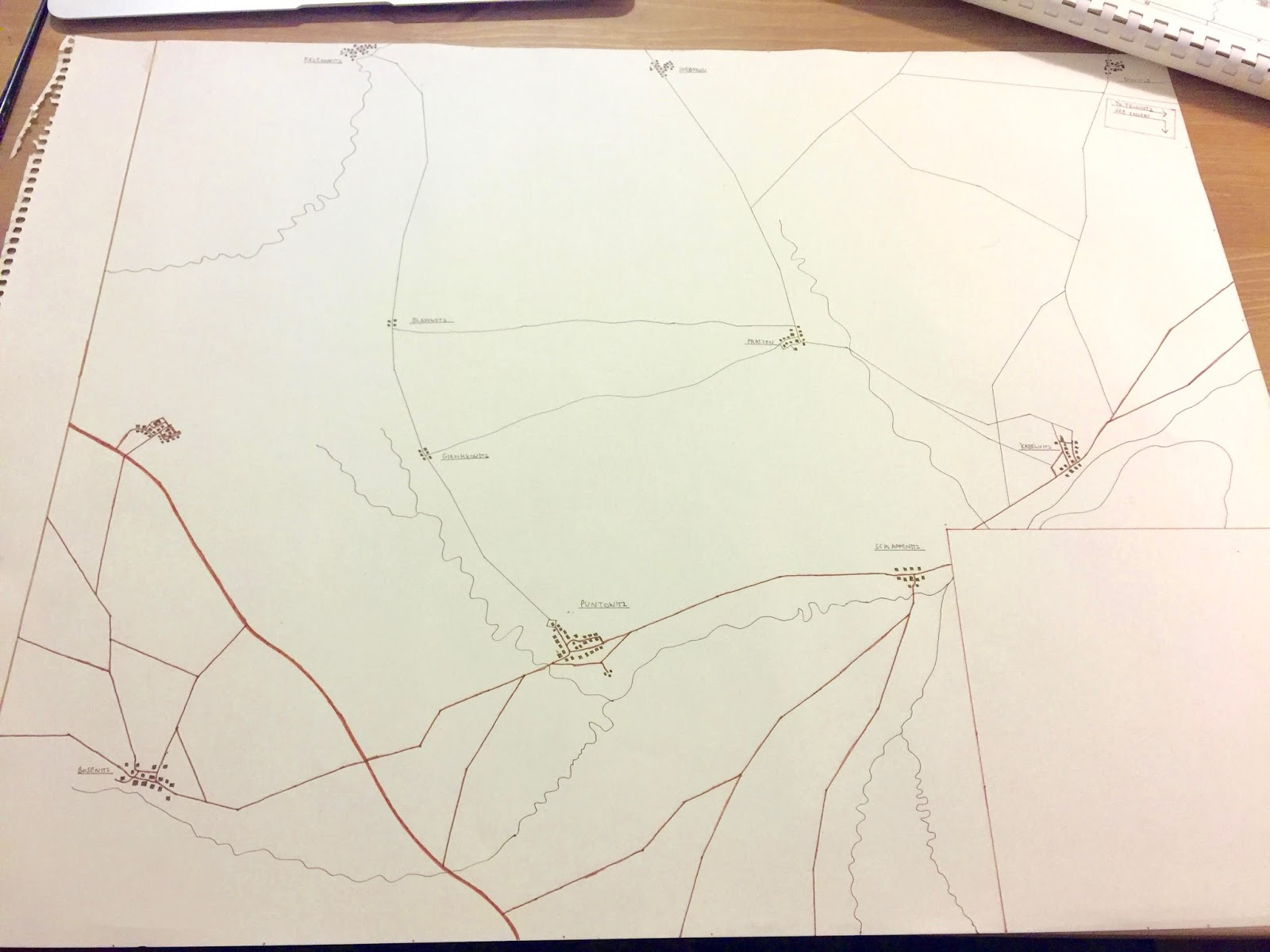i do the initial drawing in brown ink with a technical pen on the last map i left the roads in this state this time i went back over them with a