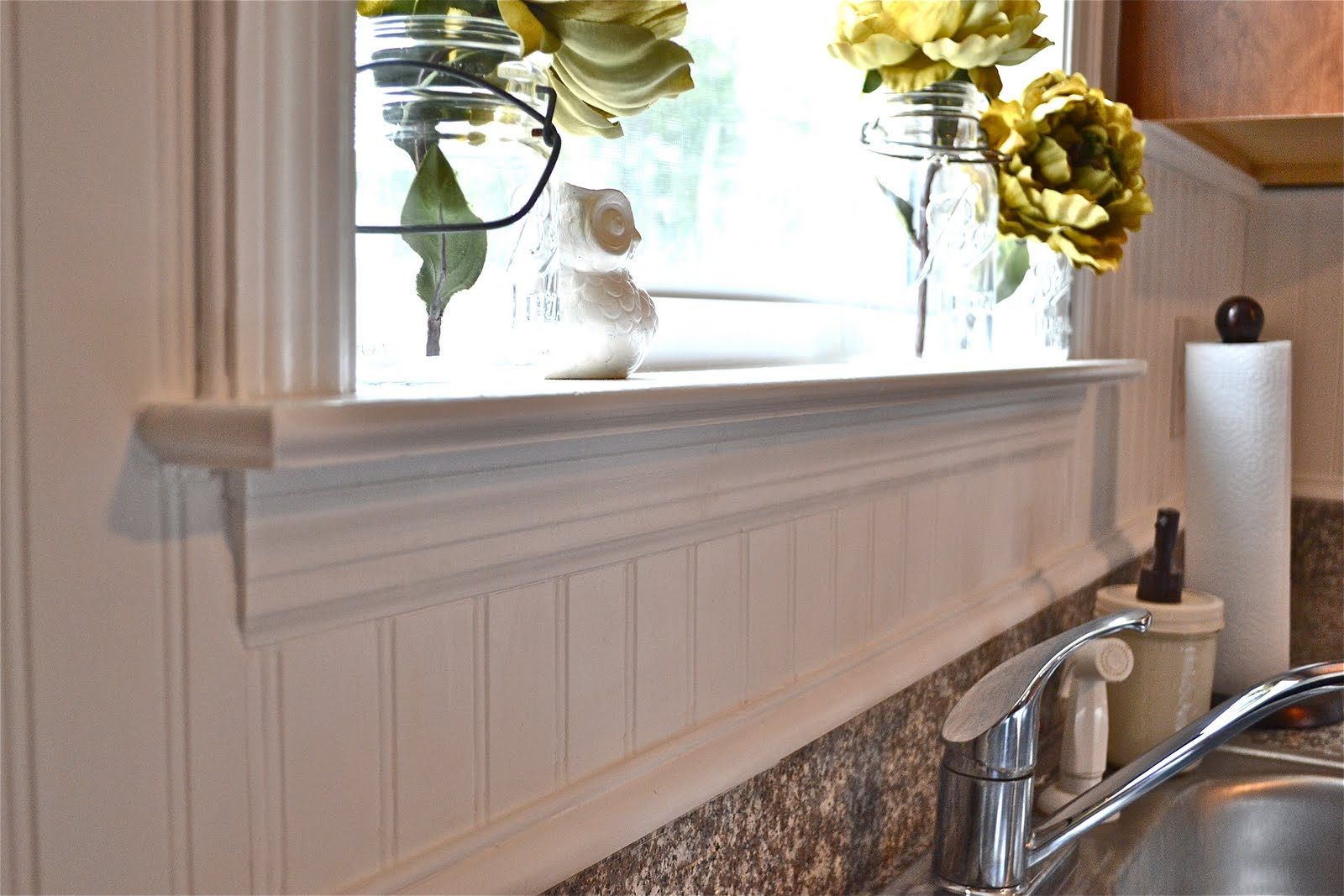 beadboard backsplash liz marie blog the caulk was used to smooth out all the edges including around all the trim pieces as you can see at the bottom where the beadboard meets the granite we